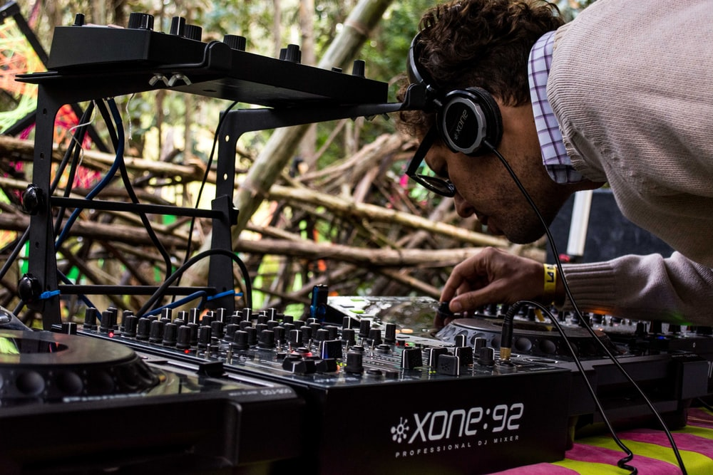 person operating DJ controller