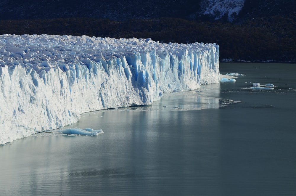 ice cliff near on body of water