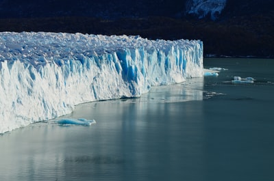 ice cliff near on body of water argentina zoom background