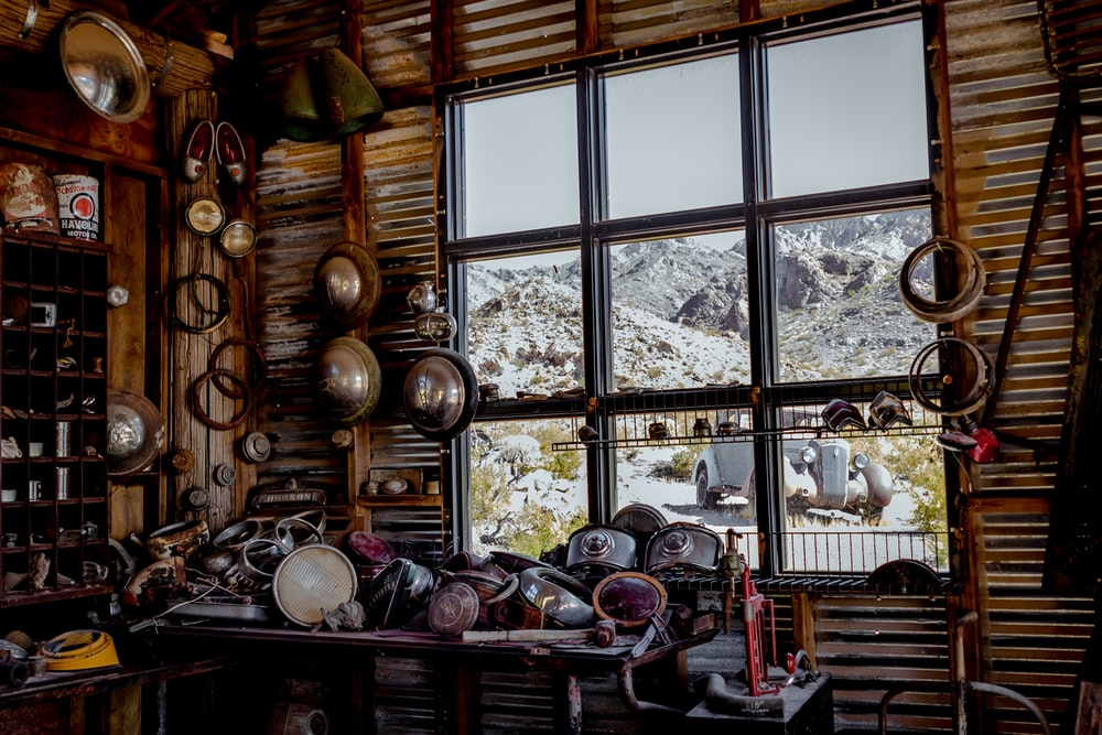 scrape metals on table near glass window