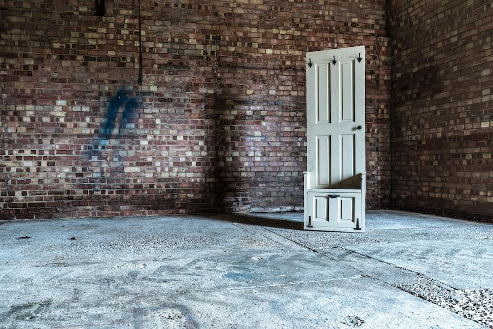 white wooden 6-panel door in room