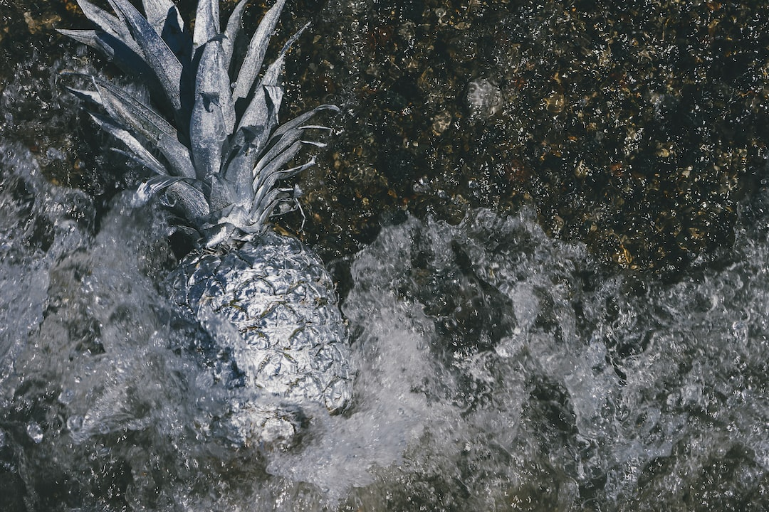 High-Resolution photo of a silver pineapple in rough water
