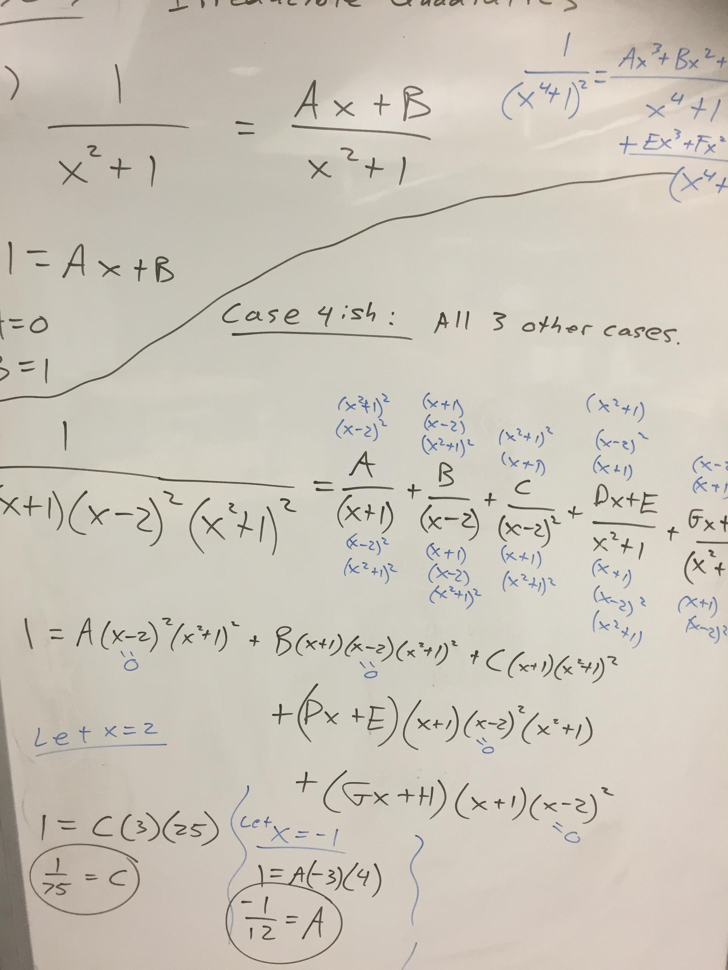 Algebra equations on a whiteboard.