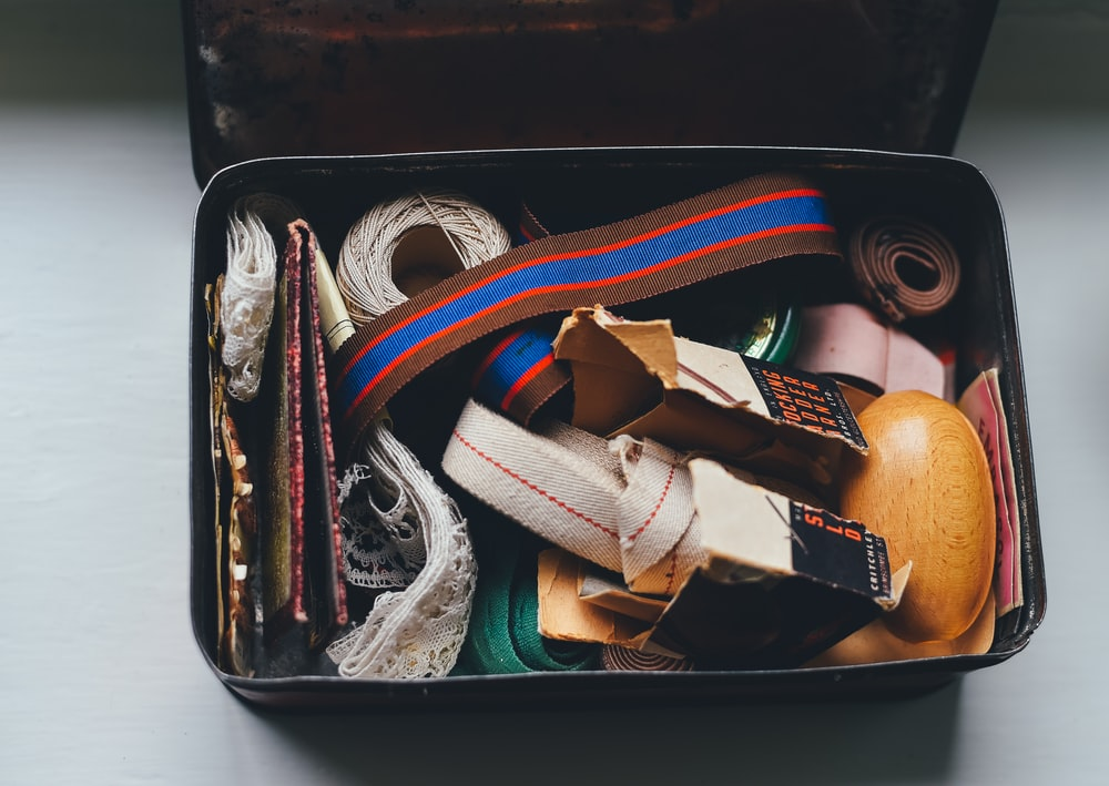 assorted belts and packs on metal case