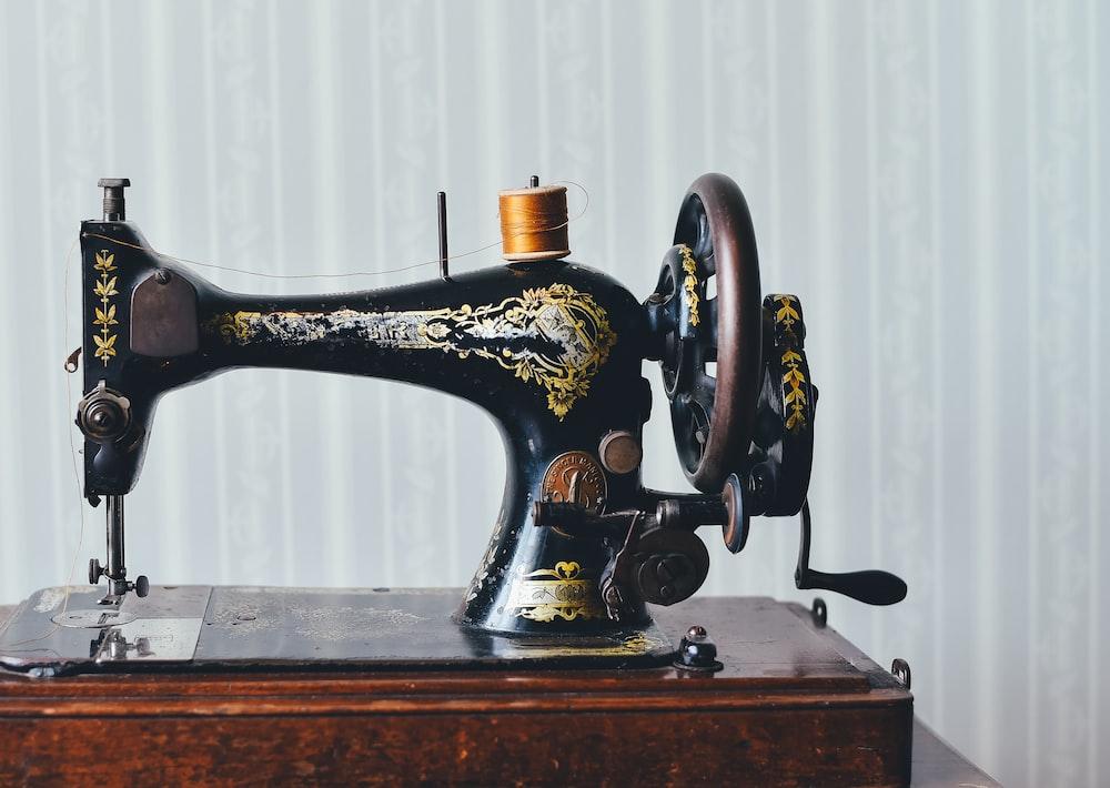 black and yellow metal sewing machine