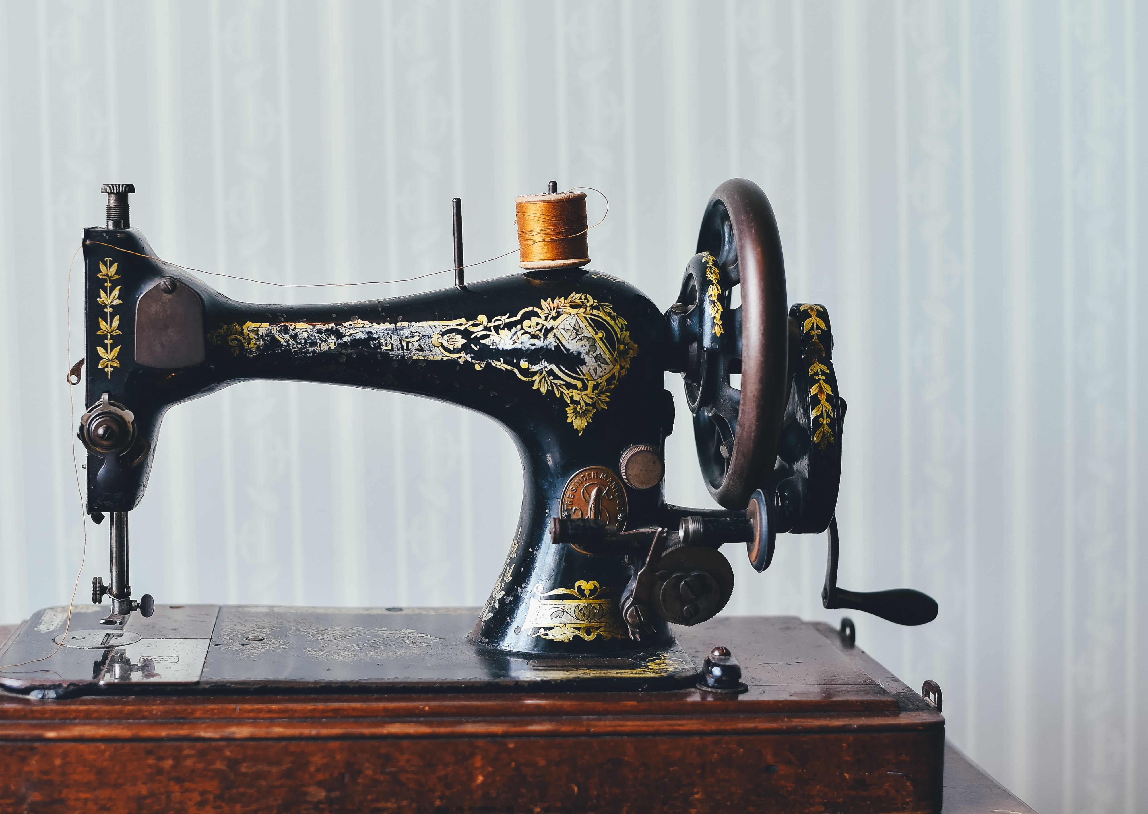 black and yellow metal sewing machine