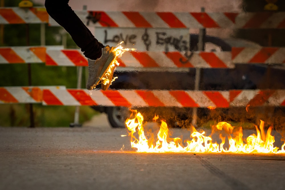 person jumping from fire