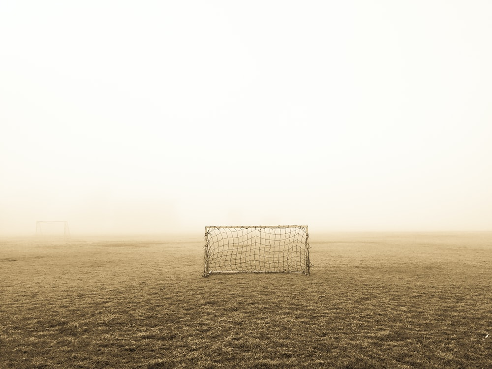 soccer goal on brown field