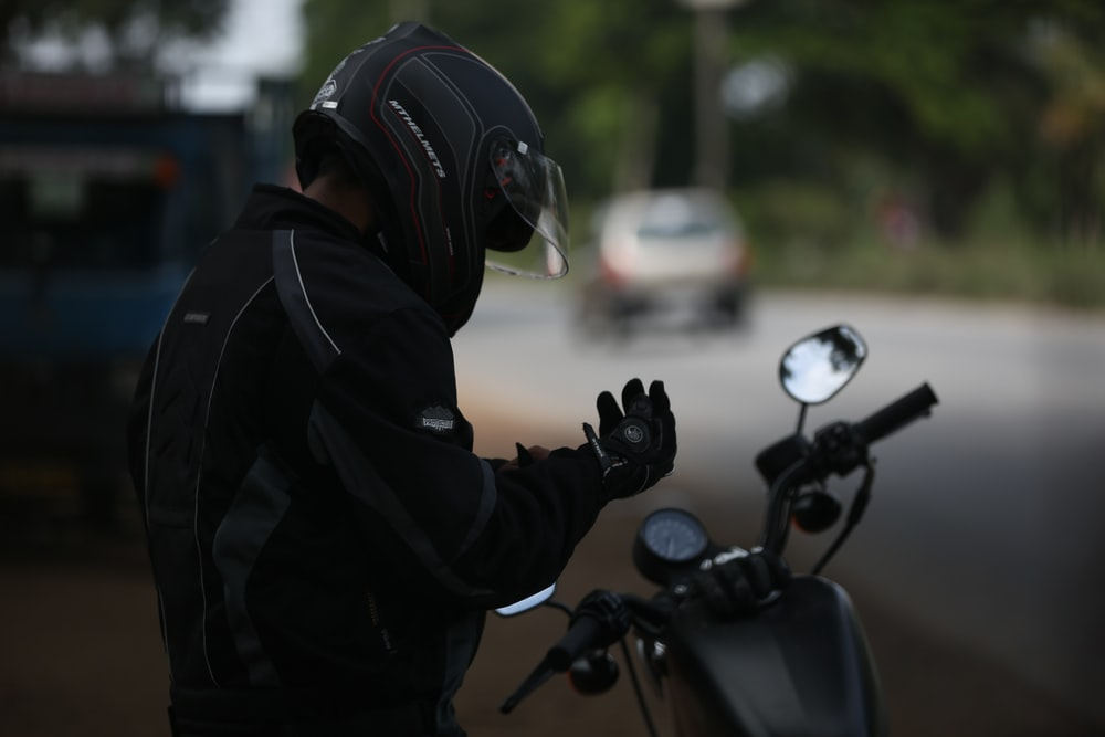 selective focus photo of man wearing motorcycle suit
