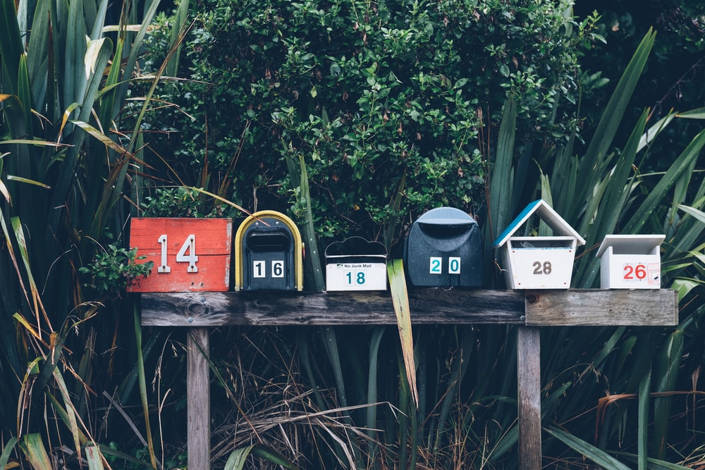 six assorted-color mail boxes