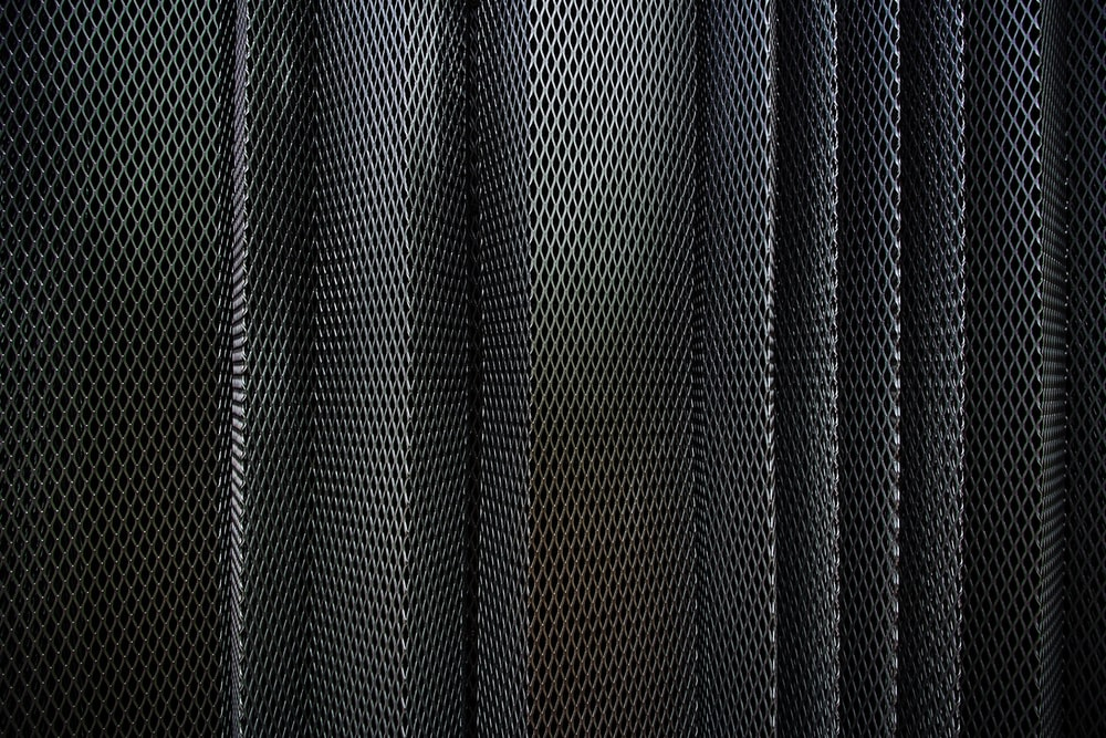 A metal criss-cross grid in undulating layers