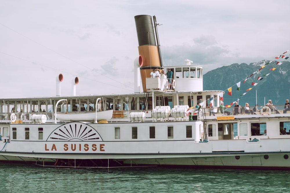 white and brown La Suisse ship