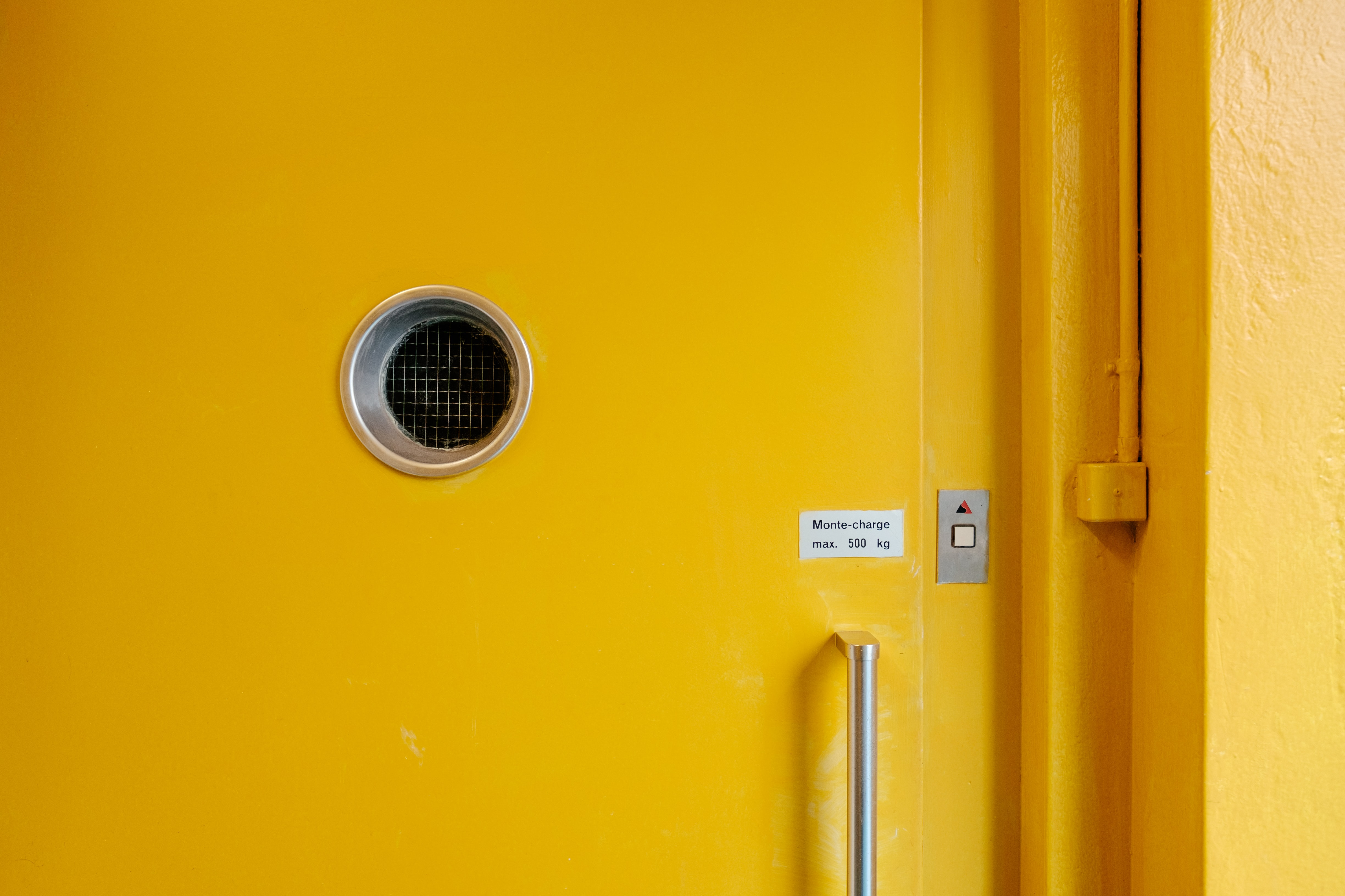 yellow door with button