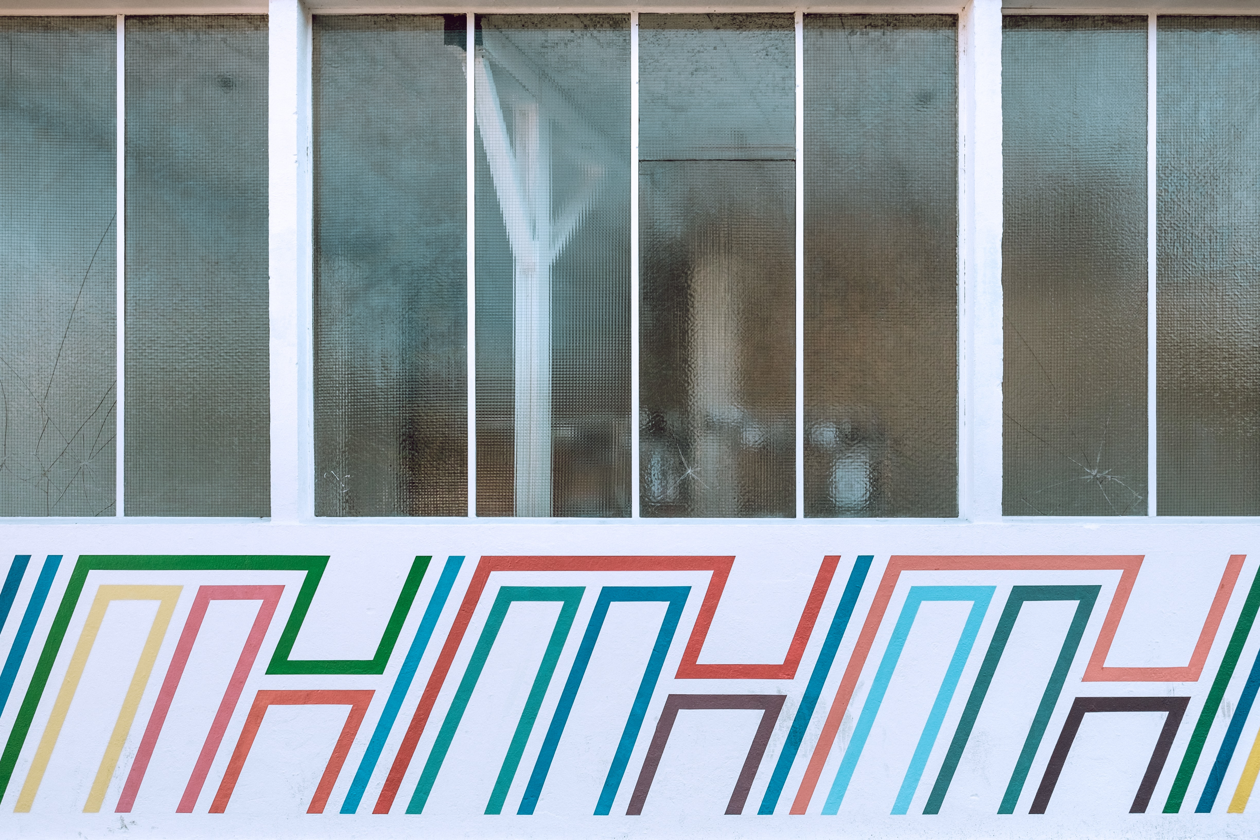 white and multicolored store signage