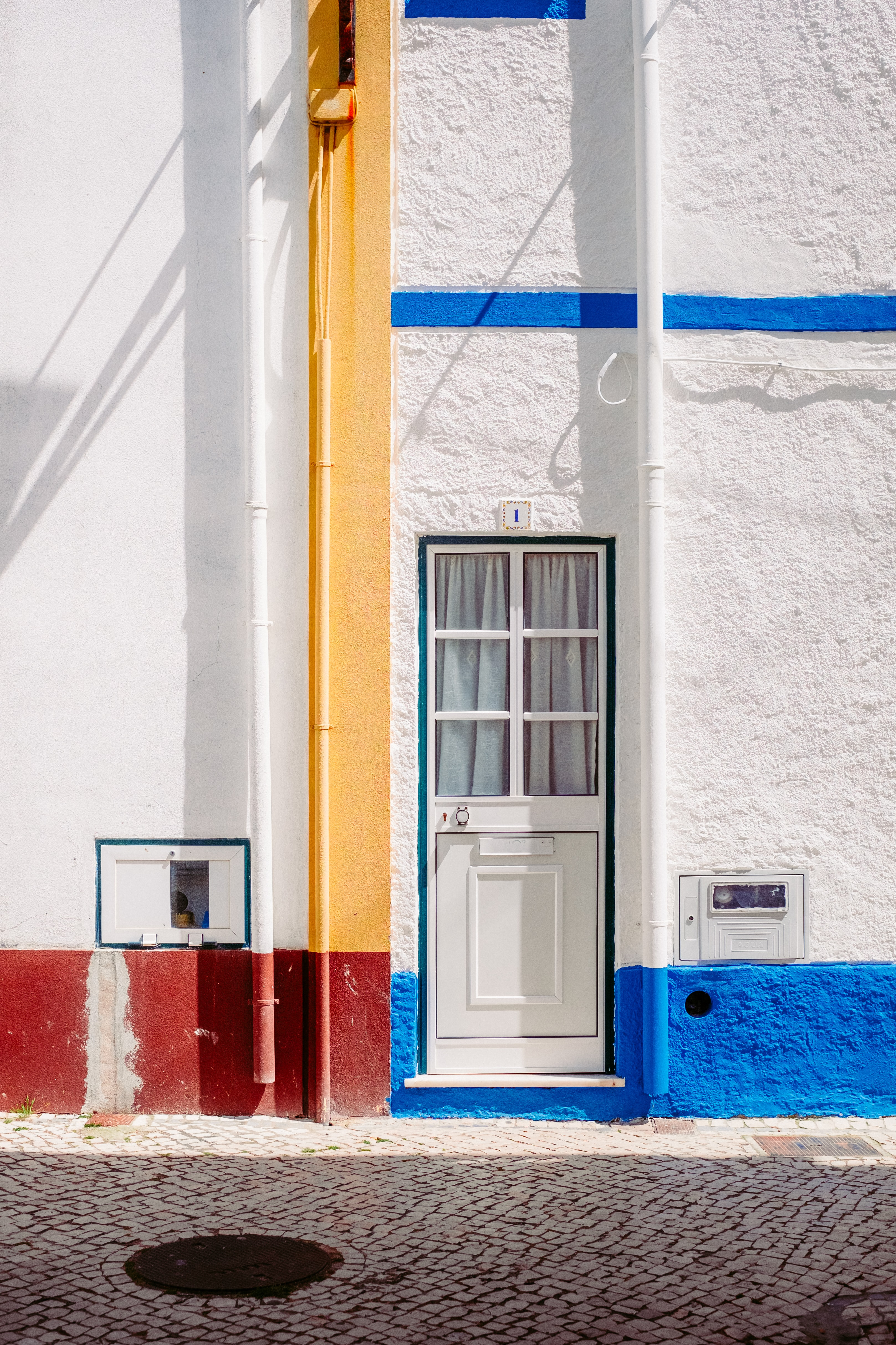 white wooden door on concrete wall