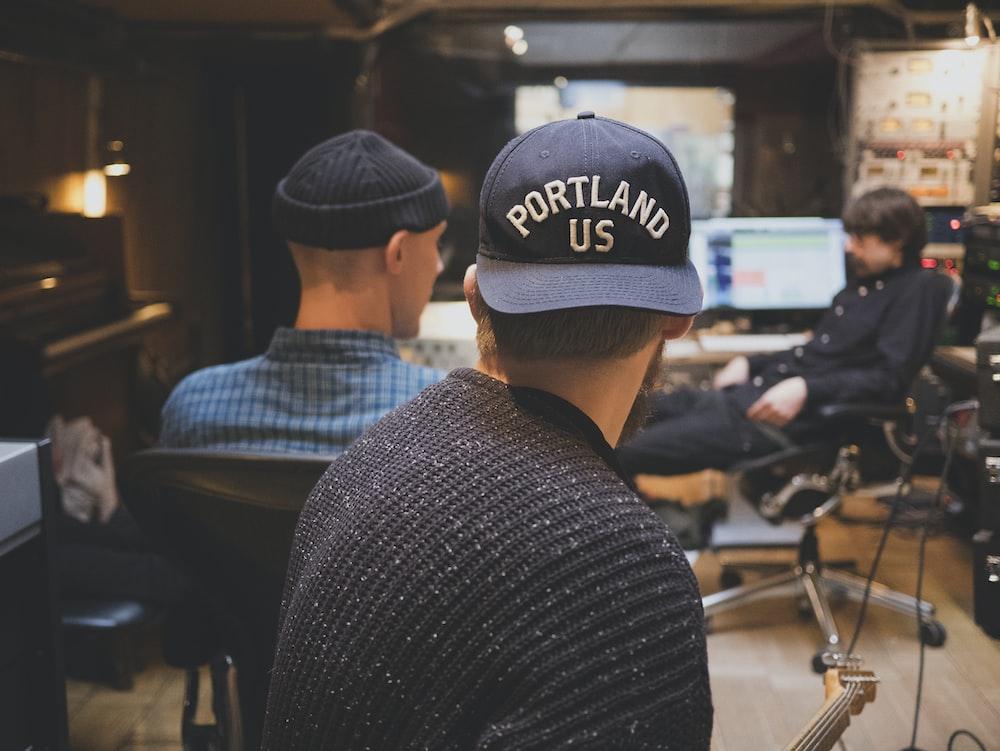 three men inside music studio