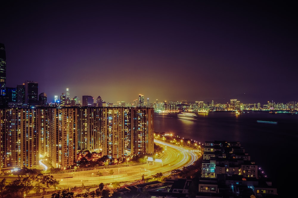 photo of high rise buildings near body of water