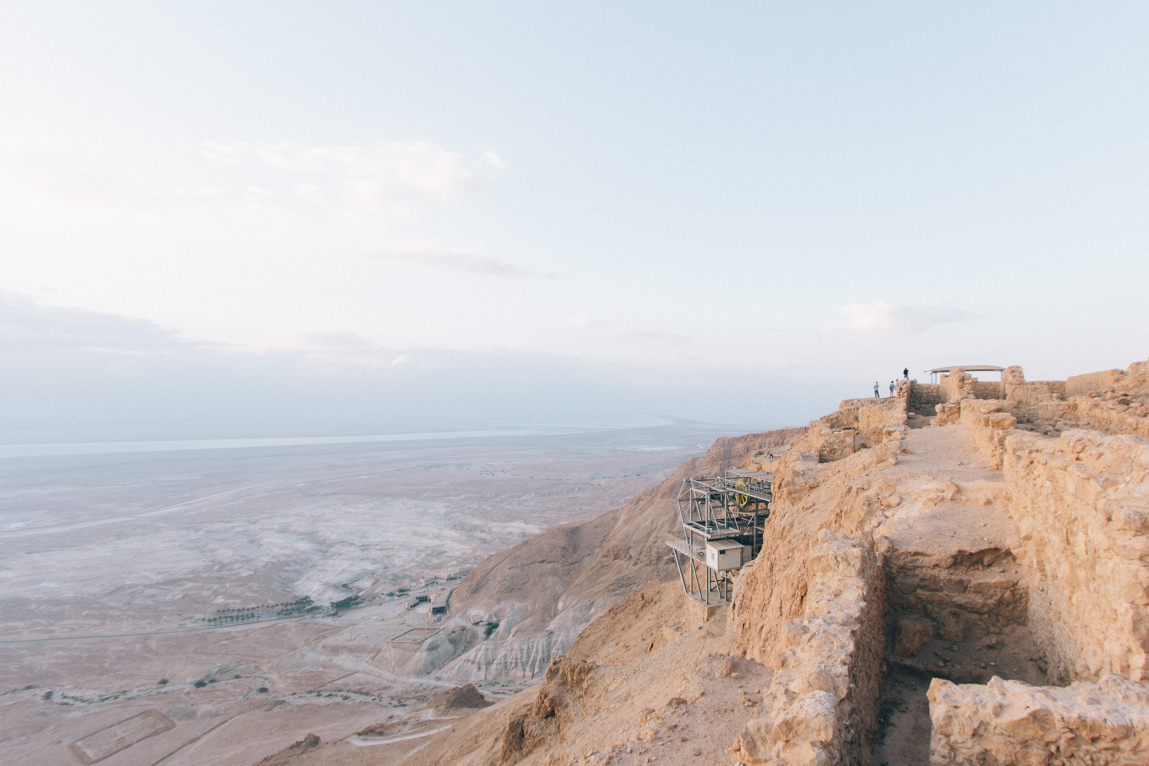 Industrial structures in the desert mountainside of Masada National Park