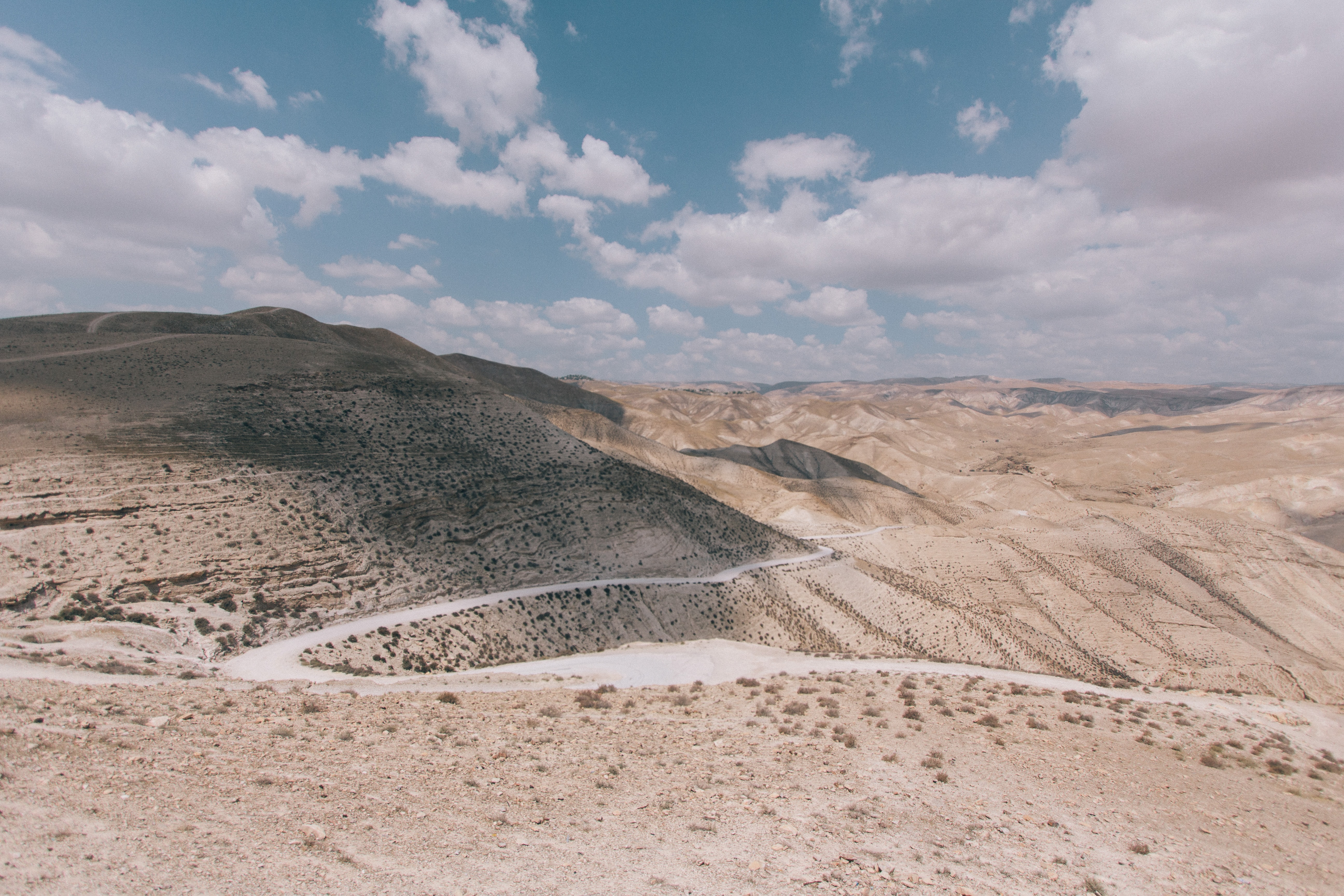 A winding desert road in the mountains in Arad
