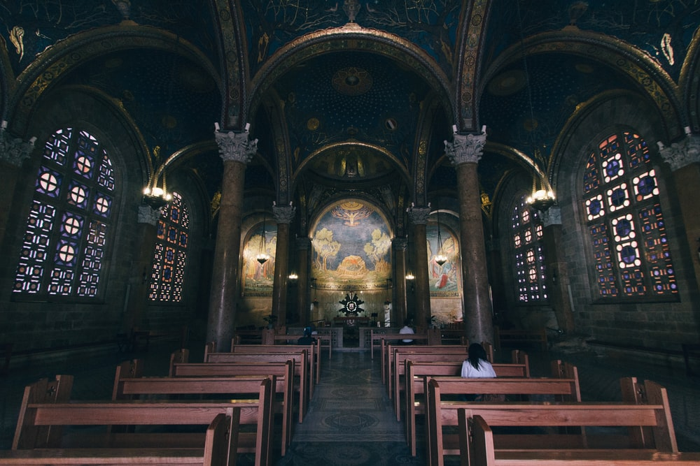 few people sitting inside church