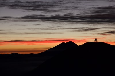 silhouette of mountain against sunlight