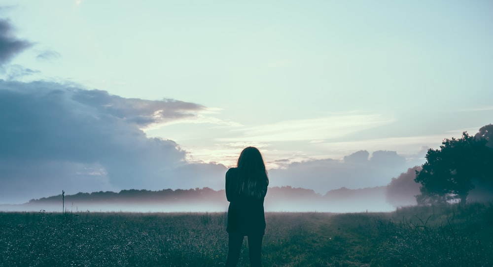 woman standing field silhouette