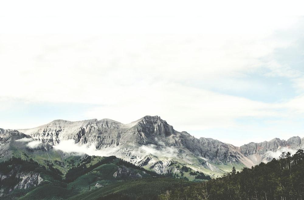 green mountains under blue sky
