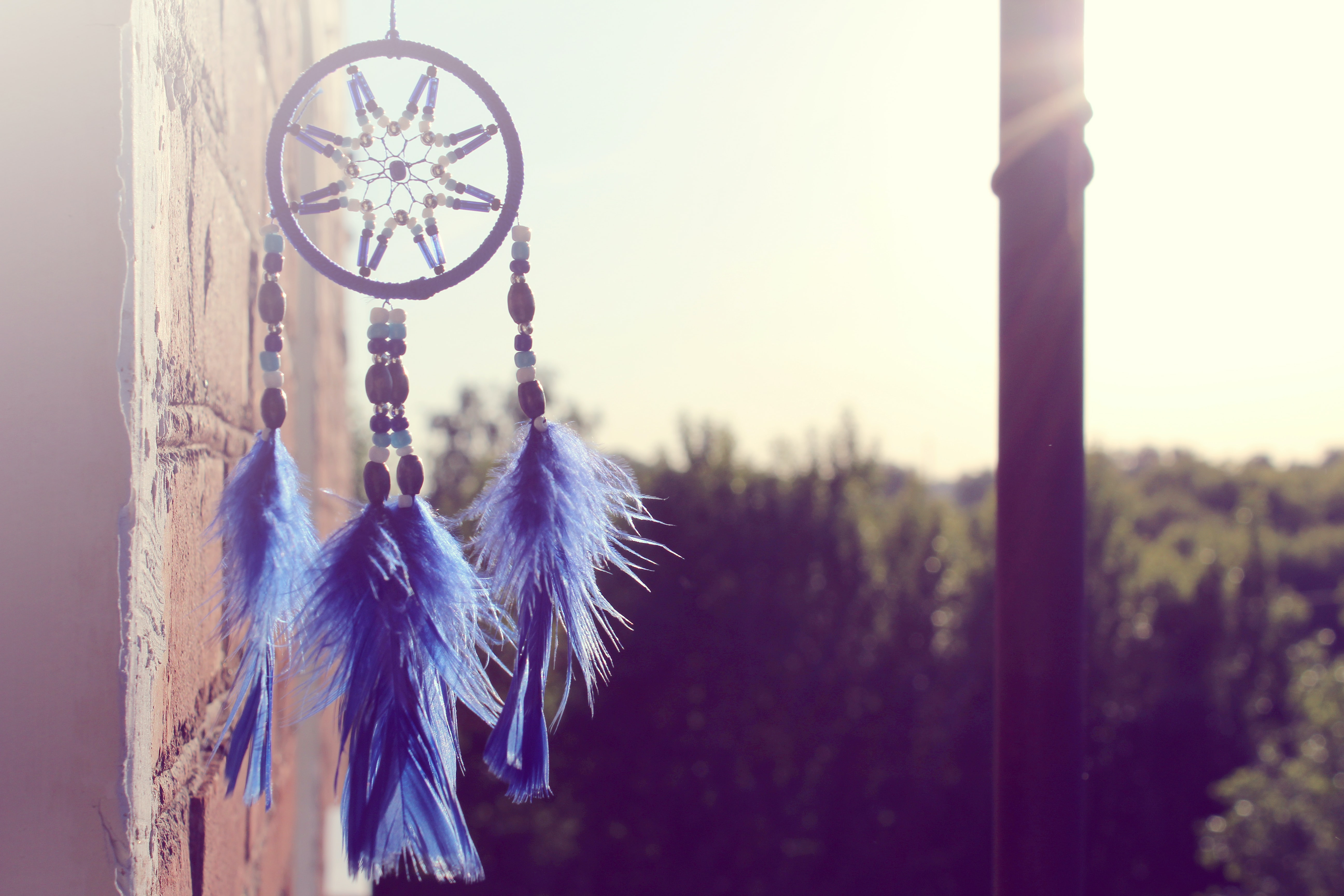 selective focus of hanging blue and black dream catcher