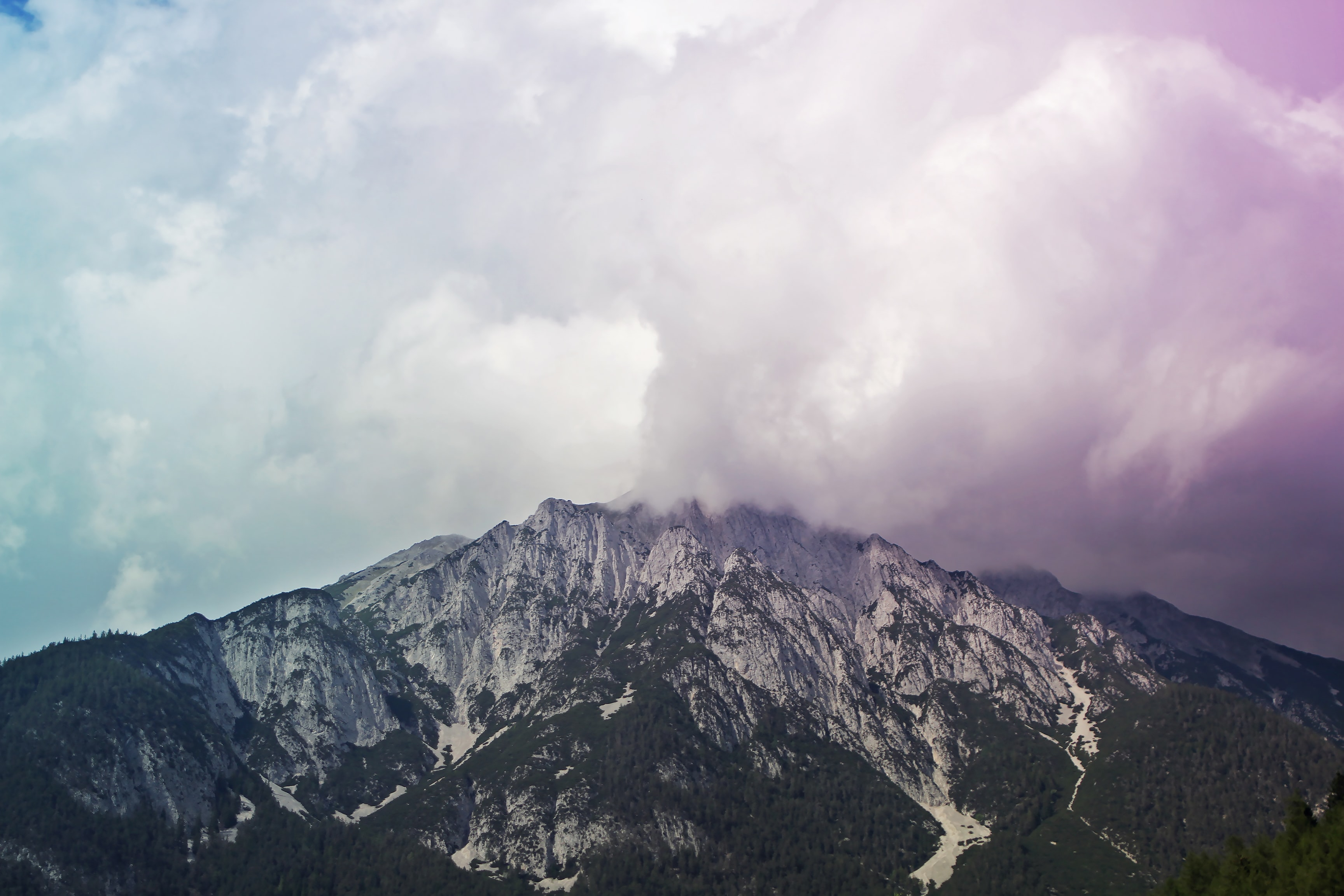 Purple-hued clouds over a rugged mountain in the Swiss Alps