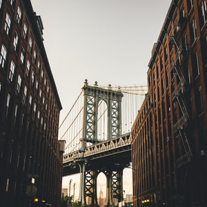 View of the Manhattan Bridge in between two New York City apartment buildings