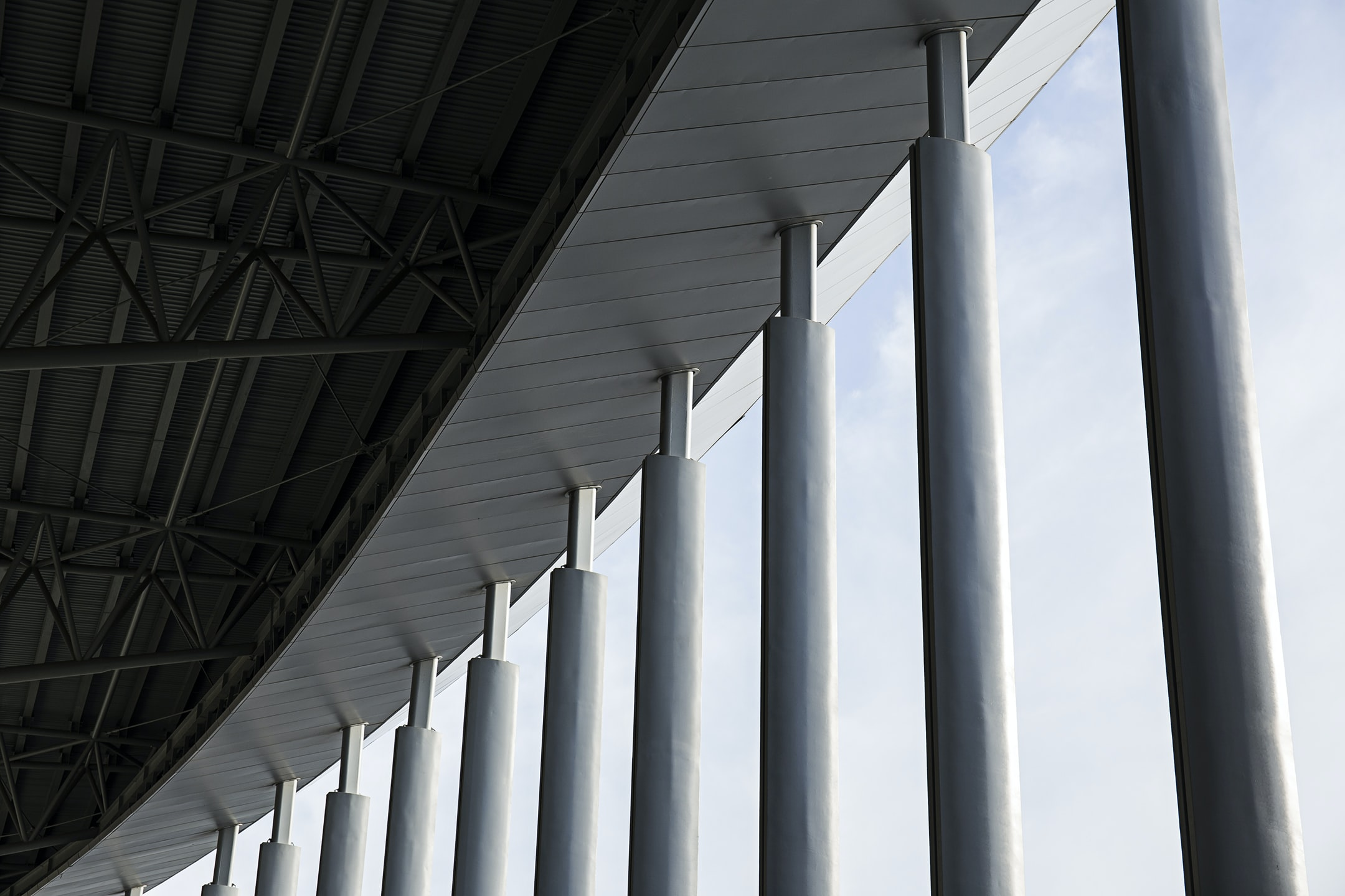 Large beams supporting the roof of a sports arena