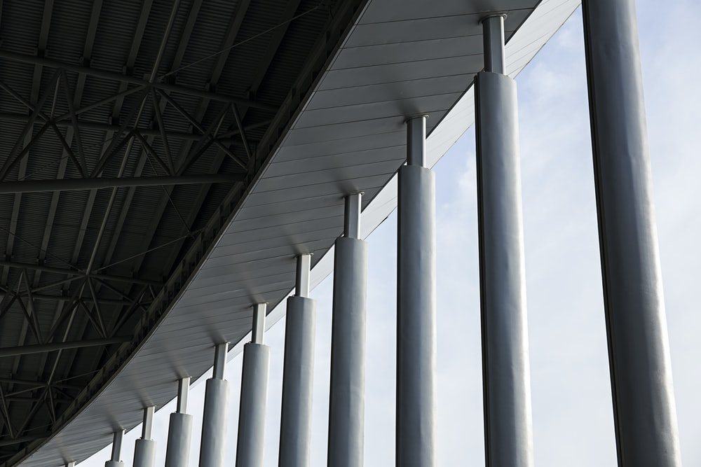 grey concrete columns of building during daytime