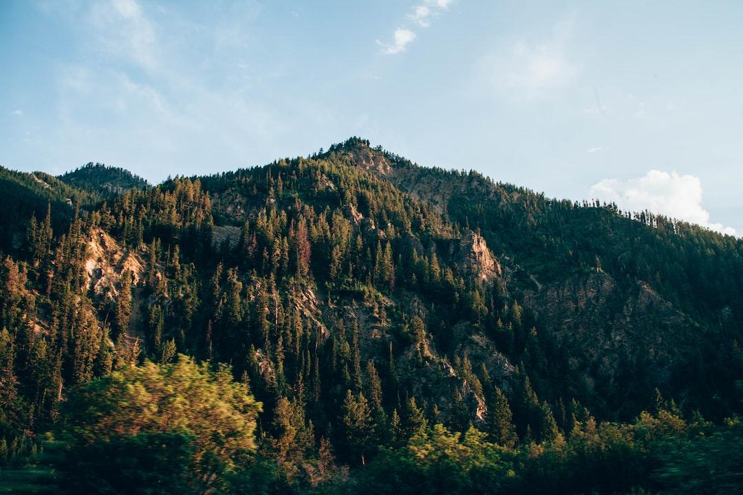 Green mountain under blue sky