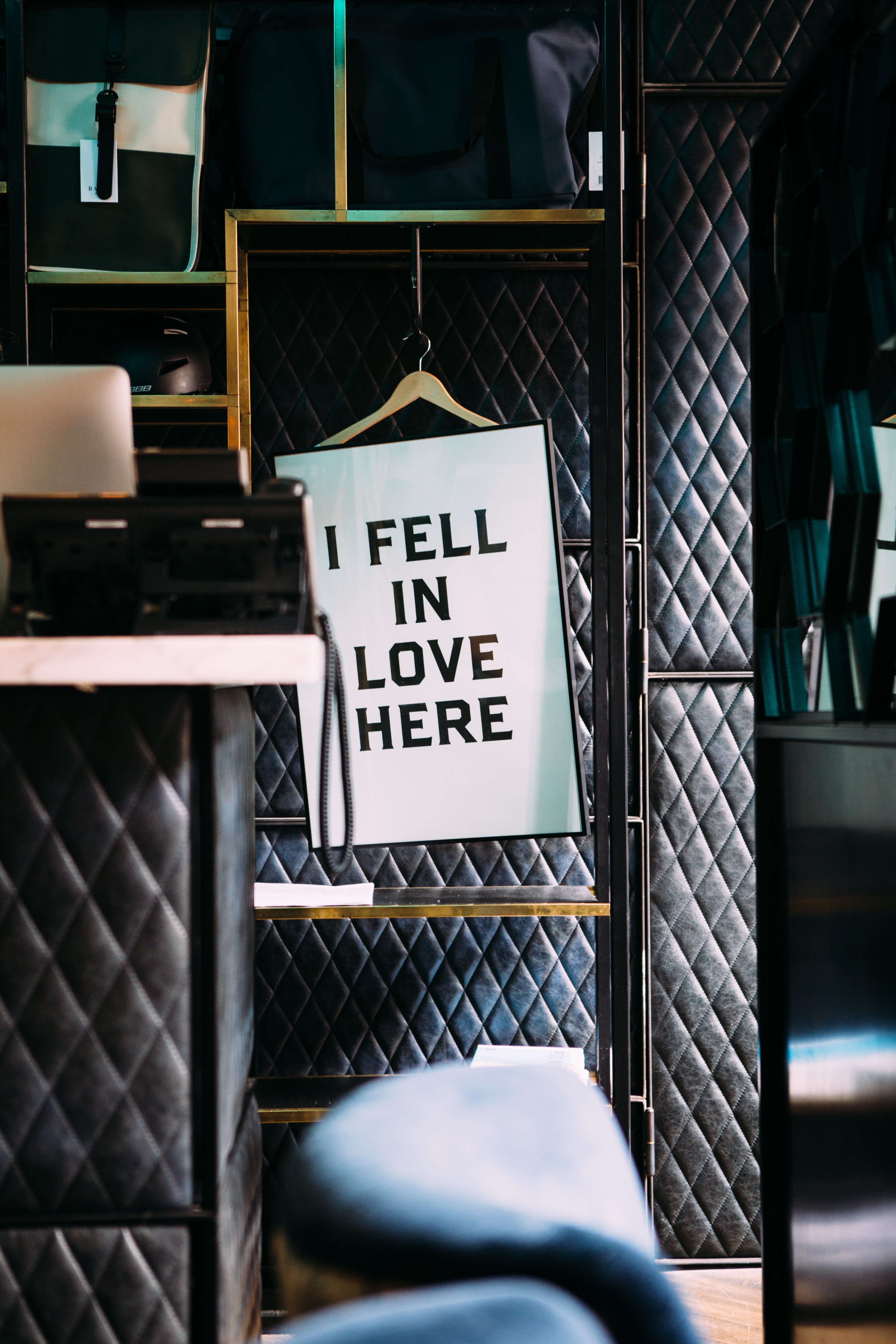 "Sign on a hanger in luxurious environment reads, ""I fell in love here."""