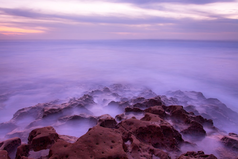 landscape photography of rock with clouds
