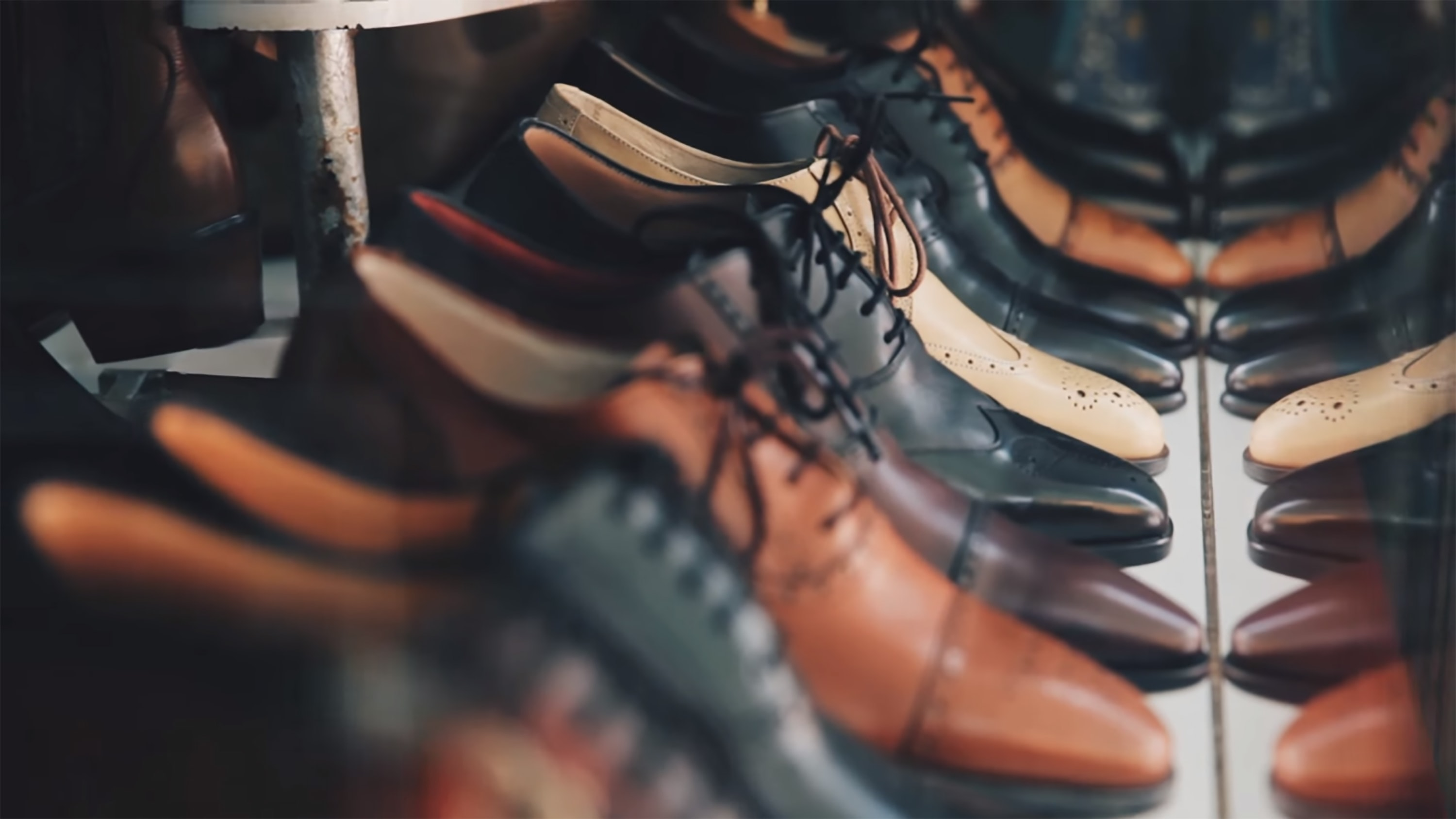 Brown, black, white, and taupe leather dress shoes
