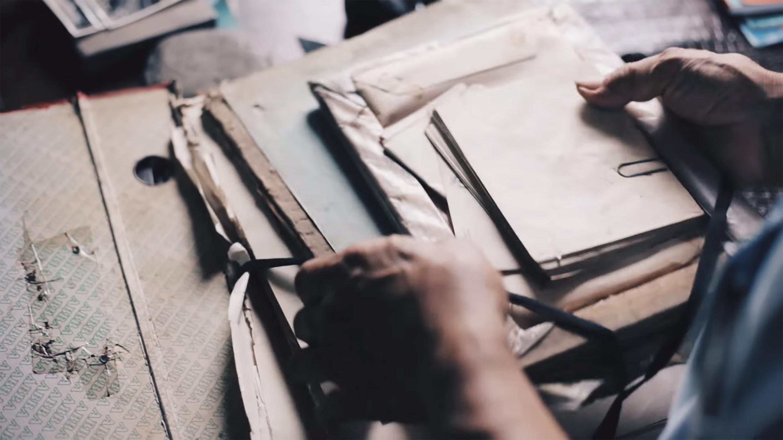 person holding envelopes