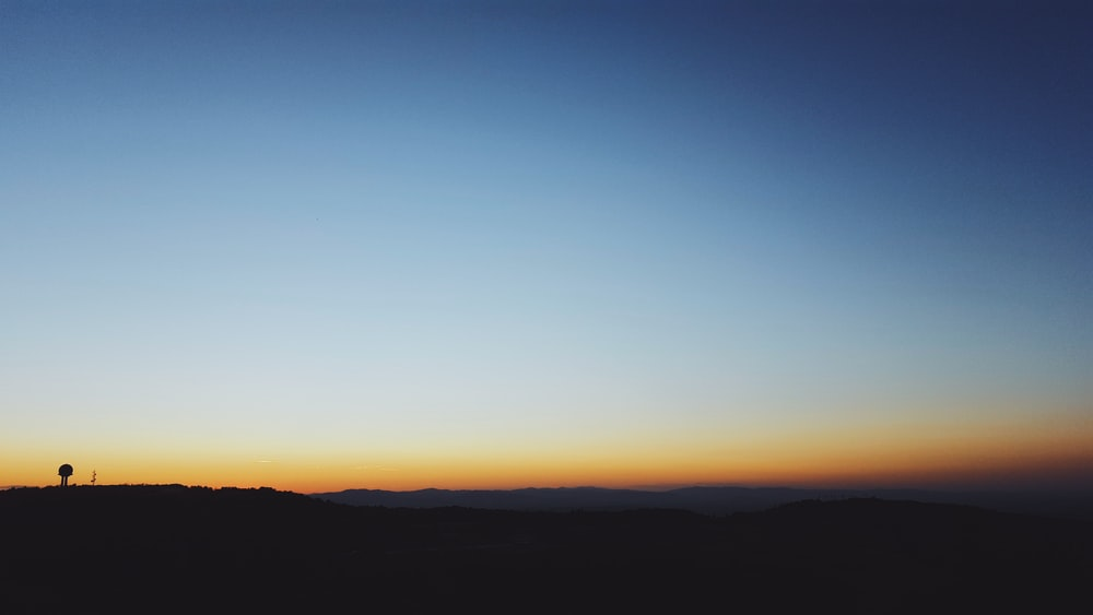 blue and brown ombre sky on horizon panoramic photo