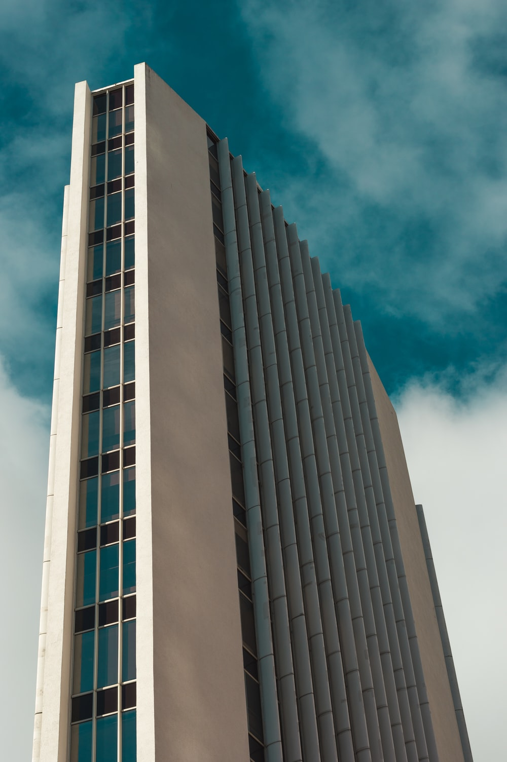 low angle photography of multi-story high rise building during daytime