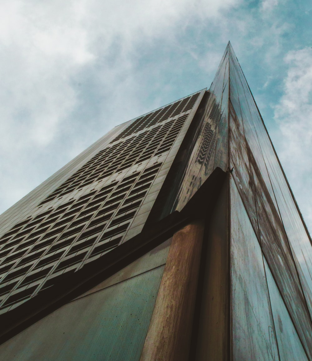 low-angle photo of high-rise building during daytime