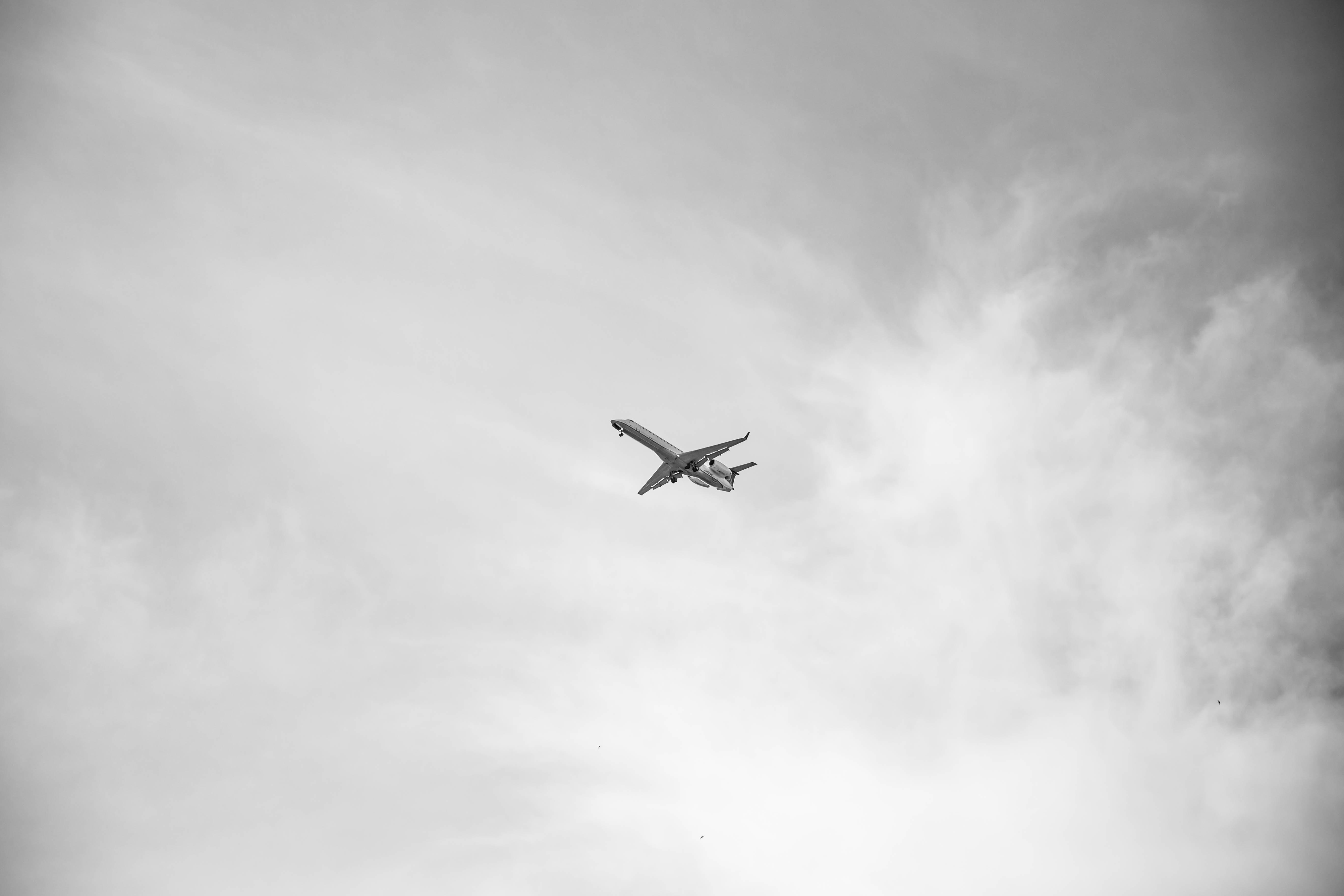 Grayscale photo of airplane