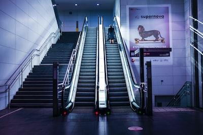 Brescia woman standing on escalator