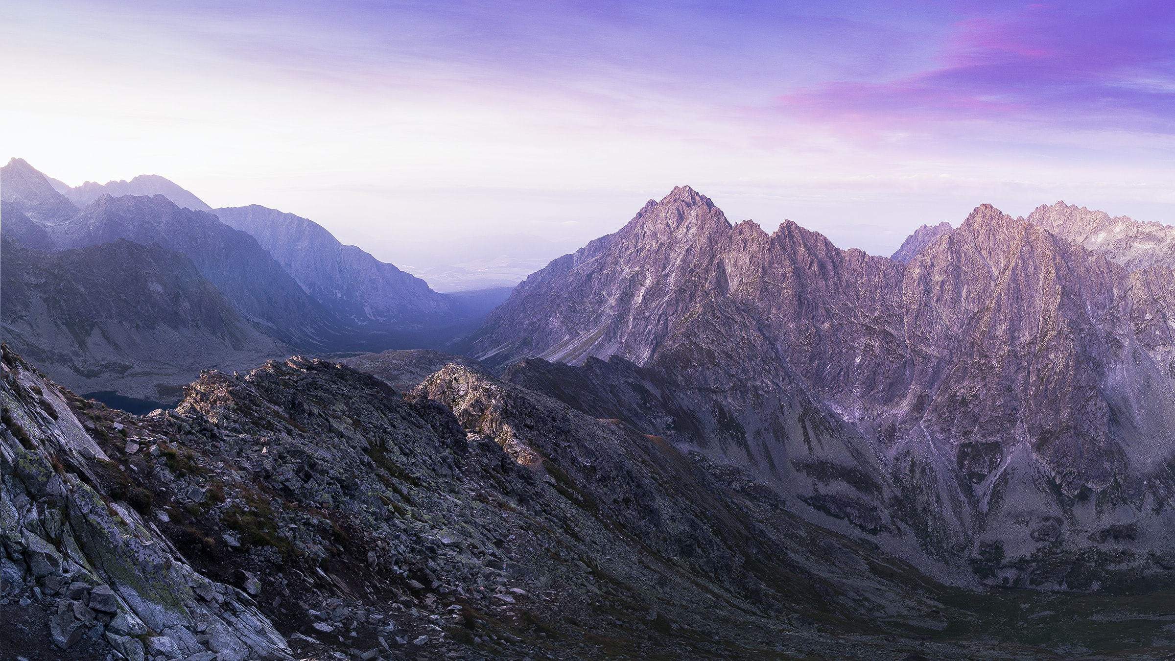 landscape photography of mountain ranges under purple and pink skies