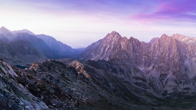 landscape photography of mountain ranges under purple and pink skies slovakia teams background
