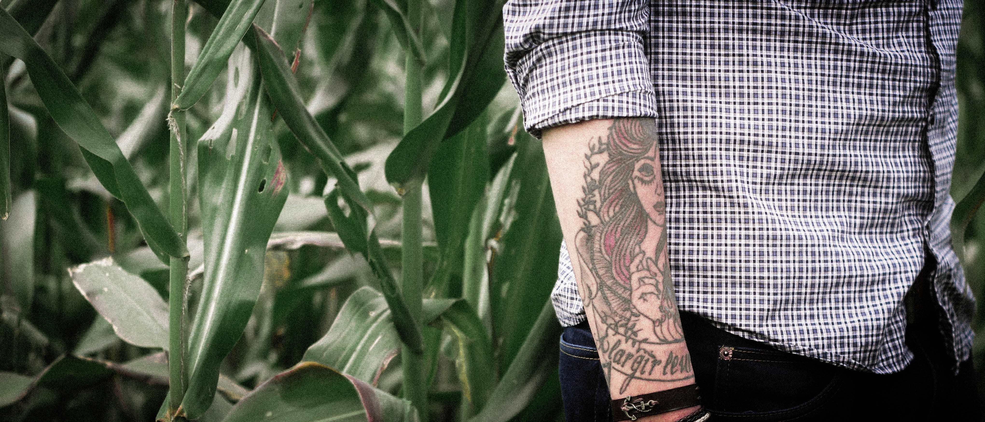 Forearm tattoo on a person with a cuffed shirt
