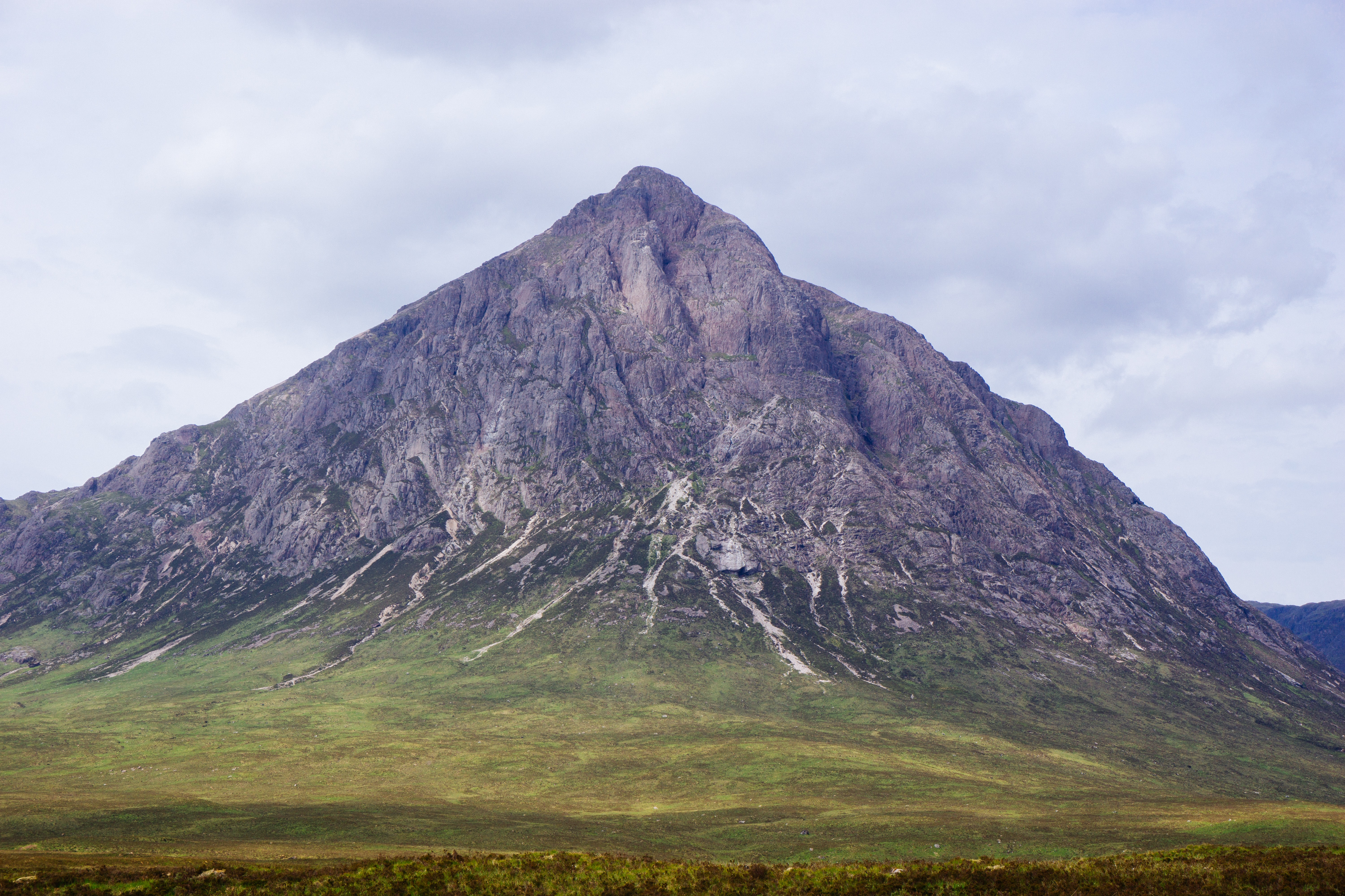 A tall jagged mountain peak in the Scottish Highlands