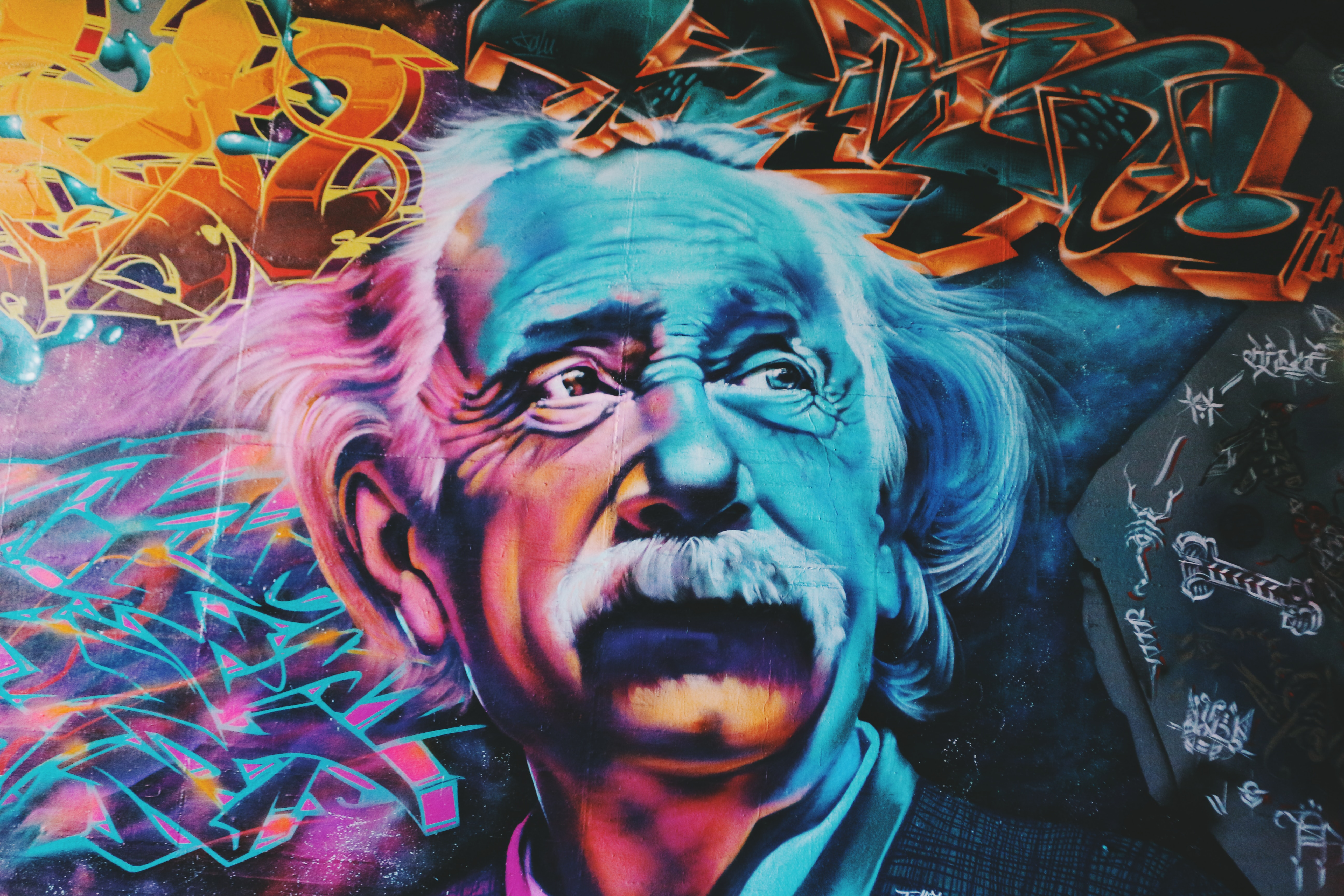 A graffiti image of Einstein. Represents dangerous knowledge to tie in my with my theme