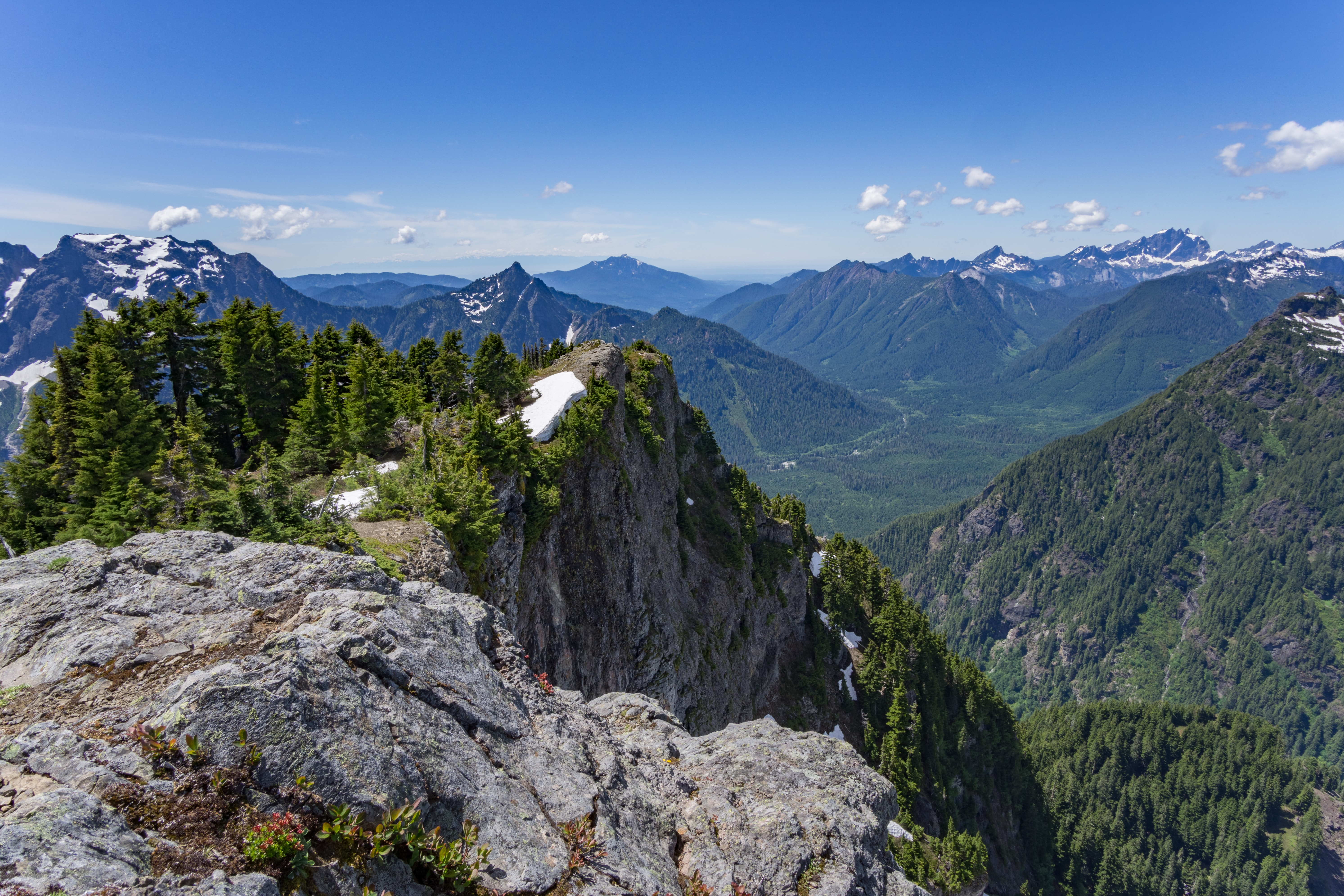 The peak of Mount Dickermann with a valley surrounded by mountains in the background