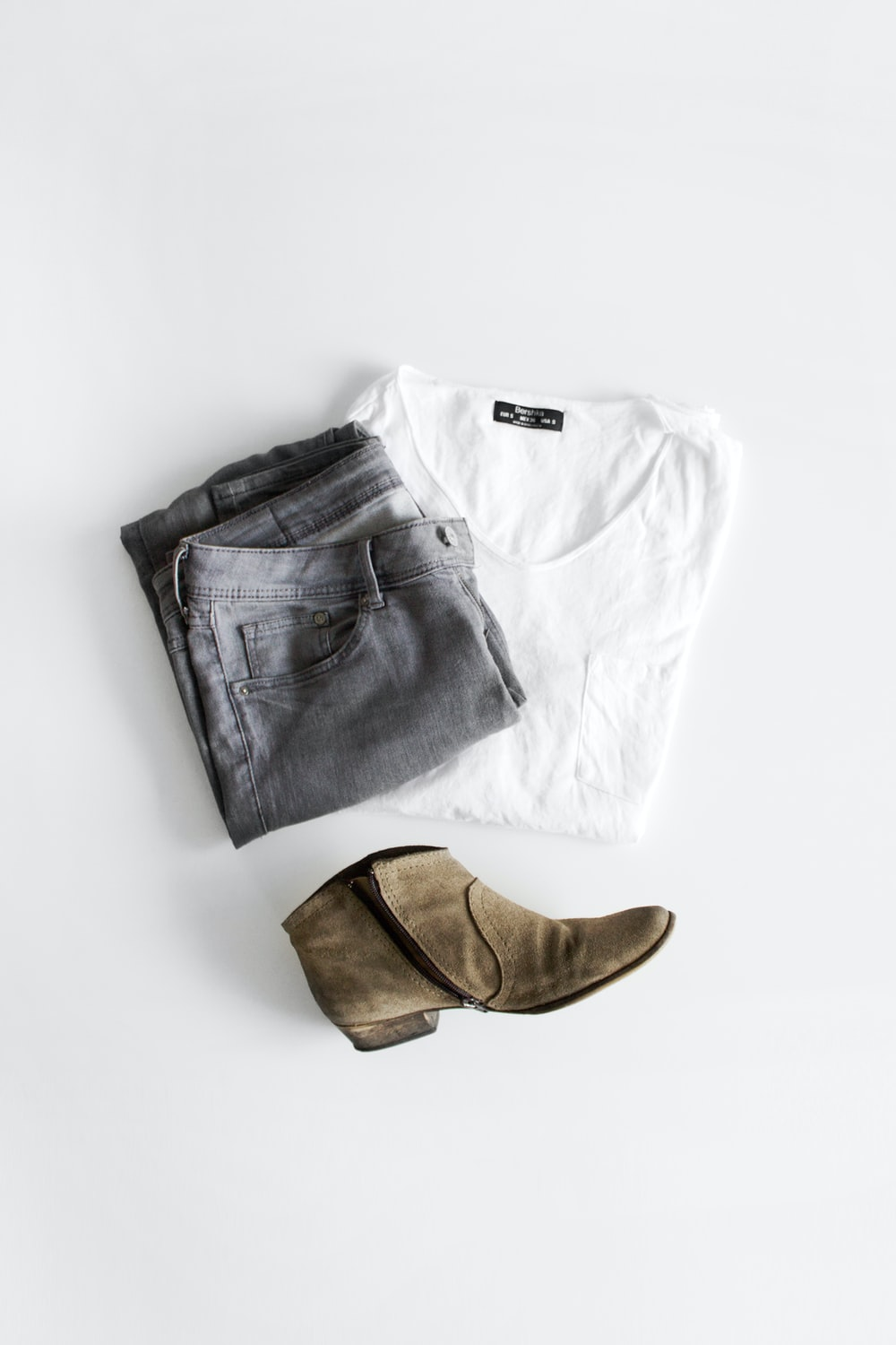 white crew neck t-shirt and brown leather boots