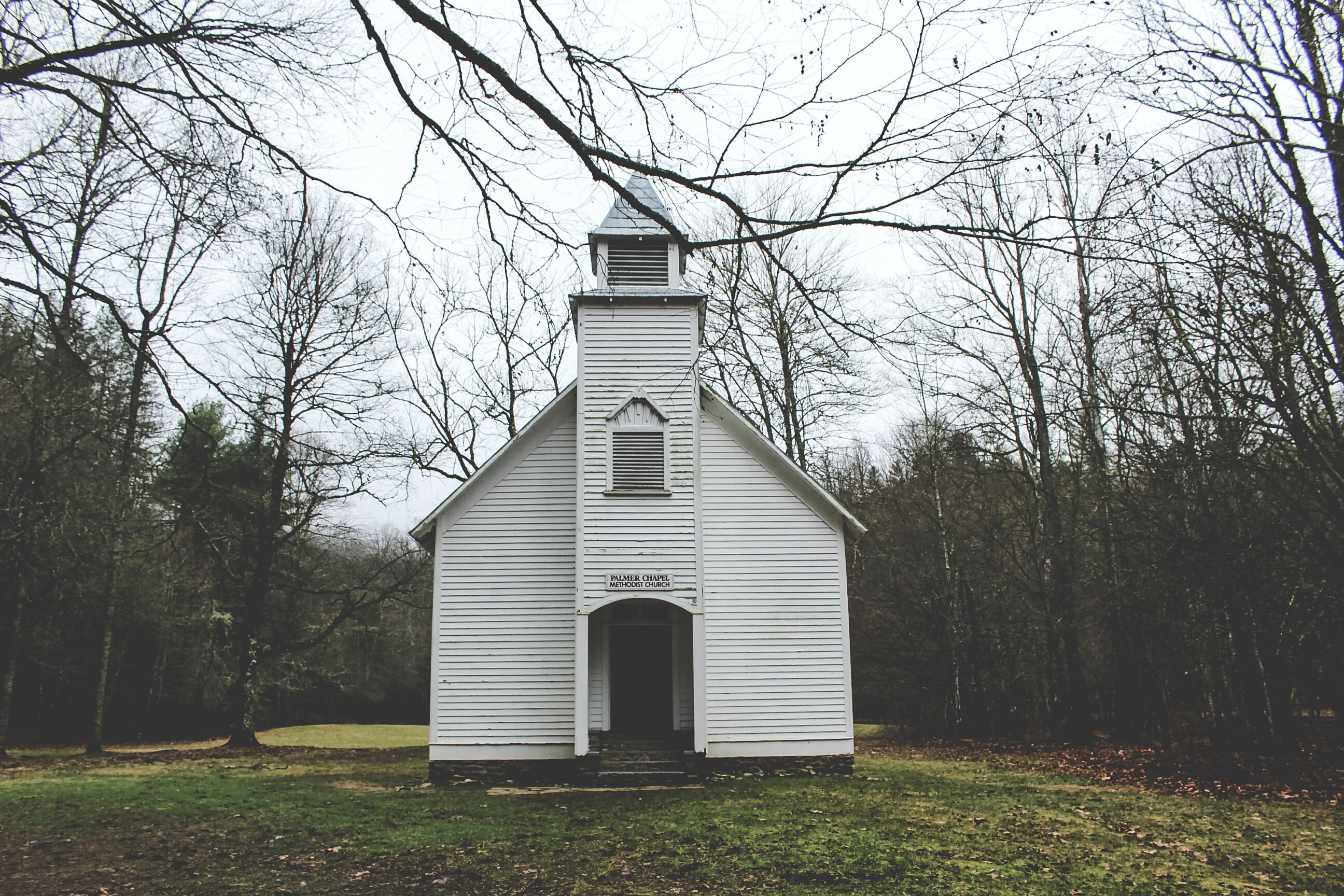 A small wooden chapel near a forest in Cataloochee